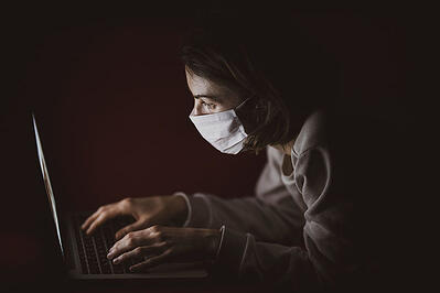 image woman working and wearing mask in times of pandemic