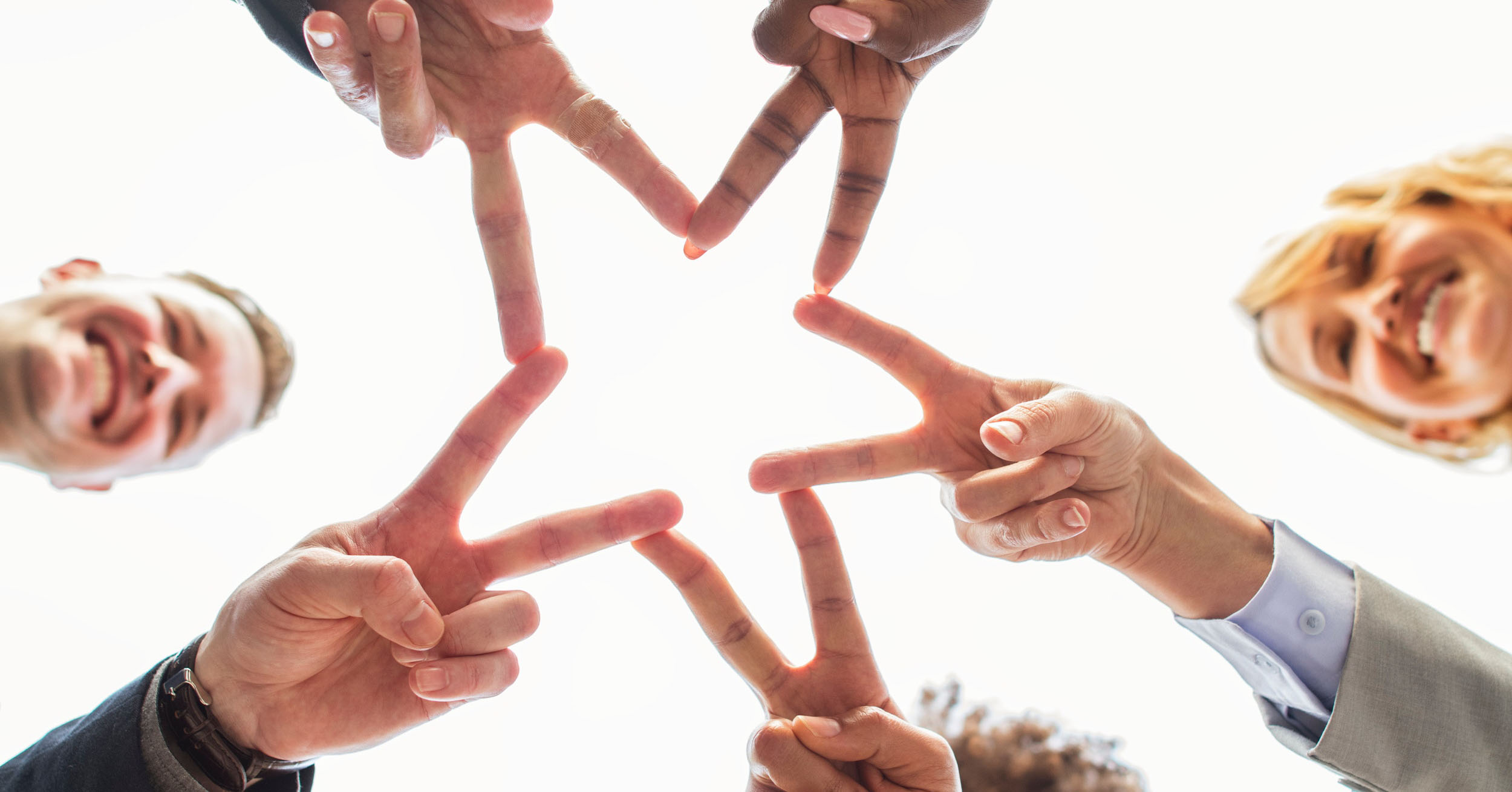 image header hands of a group of people shape of a star
